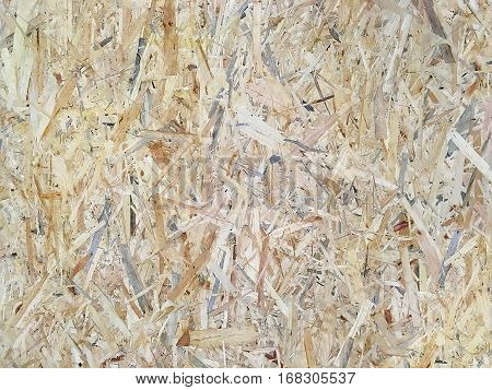 Background - Oriented strand board (OSB). Wood panels made of pressed chips closeup