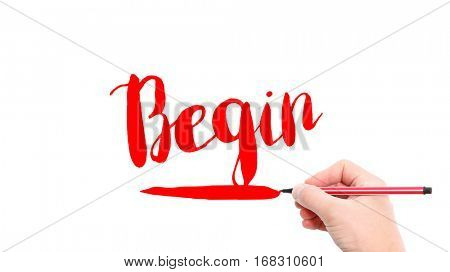 The verb begin written on a white background