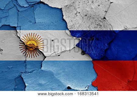 Flags Of Argentina And Russia Painted On Cracked Wall