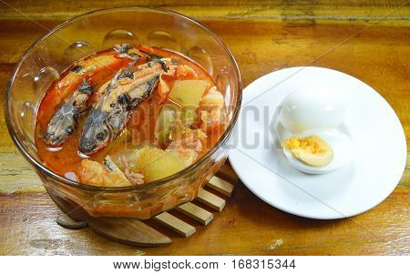 mullet with mixed vegetable in spicy soup and boiled egg