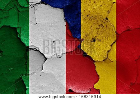 Flags Of Italy And Romania Painted On Cracked Wall