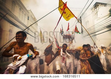 Phuket, Thailand - October 18, 2015: Parade of devotees along old town street of Phuket town in vegetarian festival.