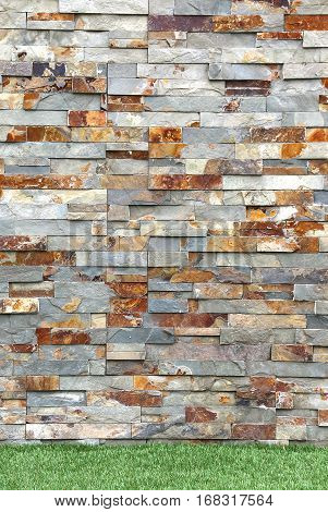 Stacked Stone Cladding covers wall exterior details with grass