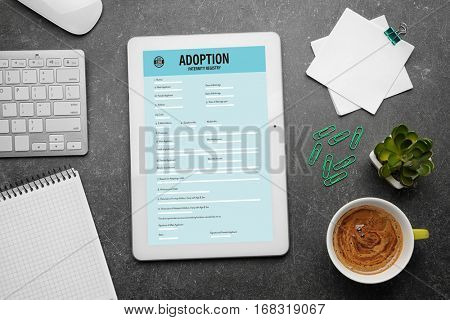 Adoption concept. Paternity form on tablet screen