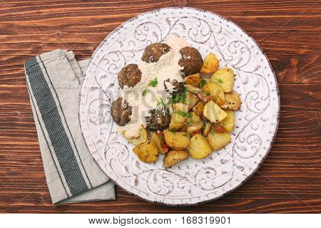 Beef meatballs with potatoes and creamy gravy.. Home-made healthy eating dish.