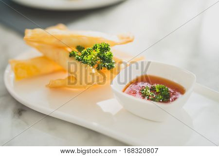 Spring rolls with sweet chili sauce. Modern Asian cuisine. Modern Asian cuisine.