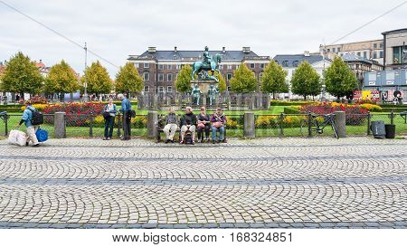 COPENHAGEN DENMARK - SEPTEMBER10 2011: Kongens Nytorv (King's New Square) with statue King Christian V in Copenhagen city in autumn day. Kongens Nytorv is public square at the end of street Stroget