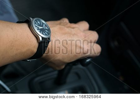 driving , left hand and gear with watch.