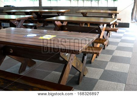 empty wood  table in canteen at school.