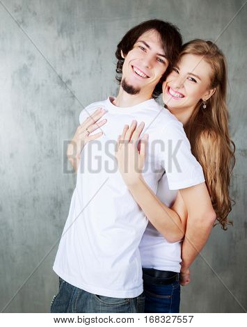 happy young couple hugging and kissing