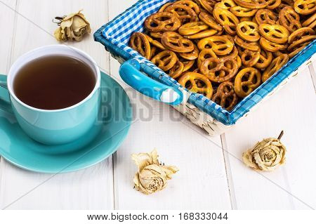 Small salted pretzels cookies in a basket on a white wooden table. Studio Photo