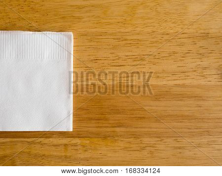 white paper napkin on wooden table background