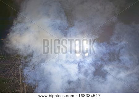 Smoke in front of headlamp during the night