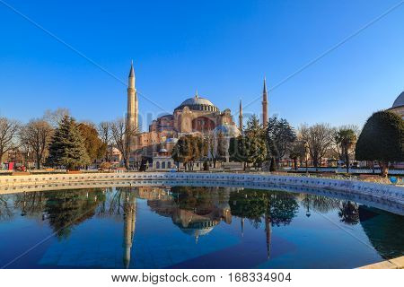 hagia sophia with reflection on water in sultanahmet square in istanbul.