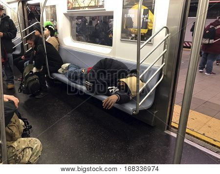 NEW YORK NEW YORK - JANUARY 6: Man sleeping on subway train. Taken January 6 2017 in New York City.