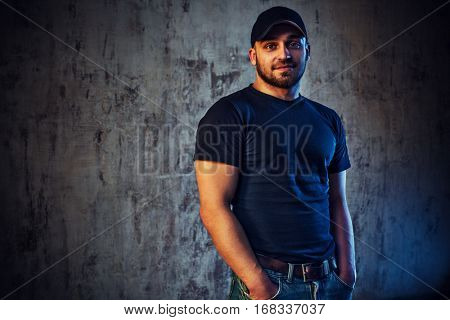 Young casual strong man portrait with cold and warm lights