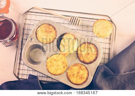 Homemade sweet cornbread in cupcake pan .
