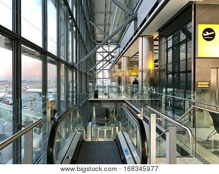 LONDON -JANUARY 8, 2017: An airside escalator at a departure gate facilitating British Airways commercial airline operations from Terminal 5 on at London Heathrow Airport, Hounslow, London, UK.