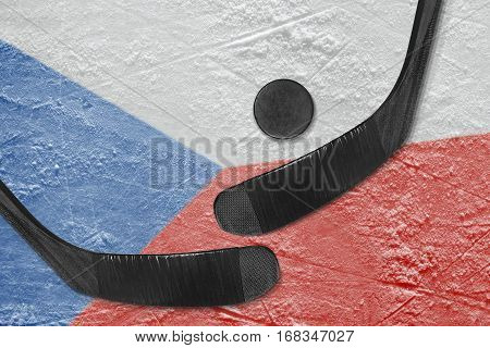 Hockey puck hockey sticks and the image of the Czech flag on the ice. Concept