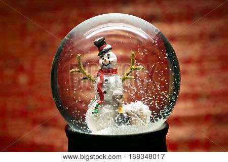 Winter Snow Globe With Snowman On Red