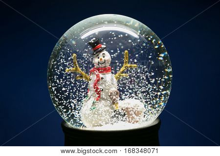 Winter Snow Globe With Snowman On Blue