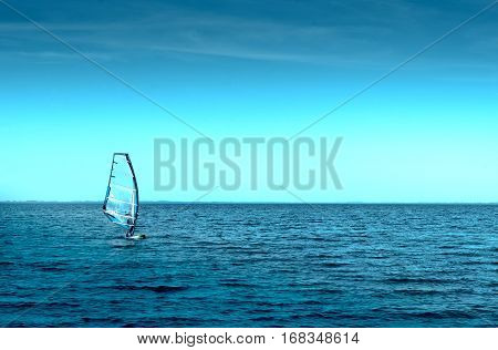 man in Sailboards at sea, windsurfing board