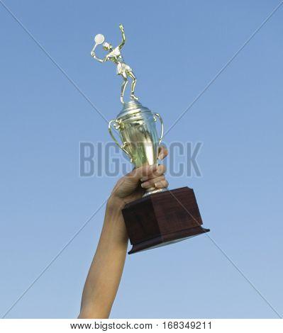 Holding Trophy Aloft