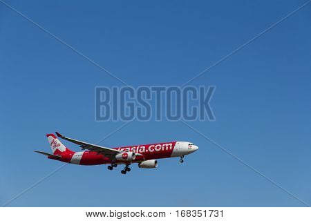 AUCKLAND NZ - JAN 30: Air Asia Airplane in Blue Sky Coming into Land at Auckland Airport on a clear afternoon on Jan 30 2017