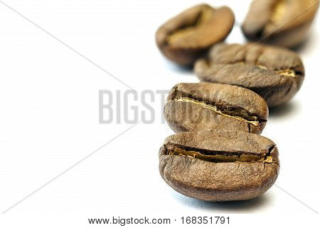 Broun Coffee Beans Isolated On White Background. Shallow Depth O