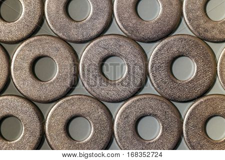 Joiner's accessories. Stacks of metal screw washers isolated on white background.