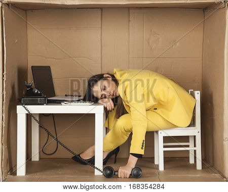 business woman asleep during a telephone conversation poster