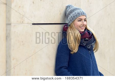 Smiling Young Woman Standing Daydreaming