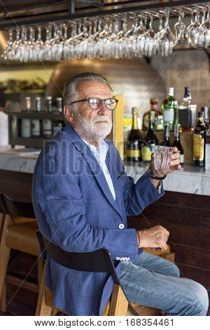 Senior Man Hangout Drinking Alcohol Night Club Concept