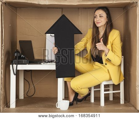 Smiling Business Woman Enjoys The Increase In Goodwill