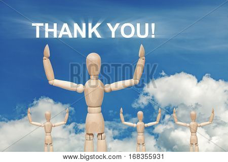 Wooden dummy puppet on sky background with words THANK YOU. Abstract conceptual image