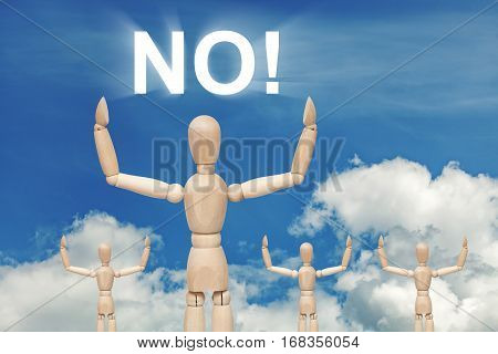 Wooden dummy puppet on sky background with word NO. Abstract conceptual image