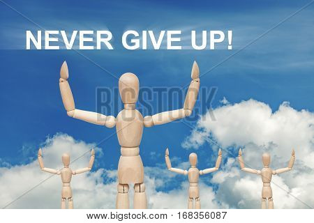 Wooden dummy puppet on sky background with words NEVER GIVE UP. Abstract conceptual image