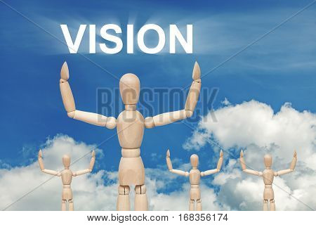 Wooden dummy puppet on sky background with word VISION. Abstract conceptual image