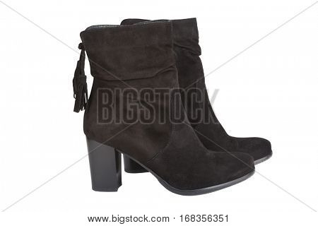 Black ankle boots with a tassel isolated on white