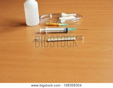 Medical syringe and dropper on the table
