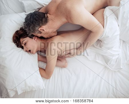 Couple In Love Having Intimate Sex In Bed