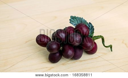Grapes with leaf on wood background, Fake grapes