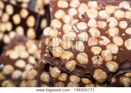 Chocolate bars with hazelnuts on sale in street market