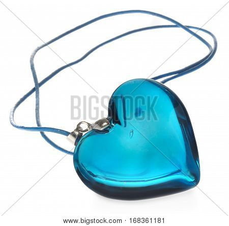 Blue crystal heart on a blue leather thong. Crimson transparent glass necklace. Jewellery isolated on white background with light shadow.