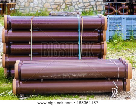 Stack sewerage tubes vitrified clay on building deposit