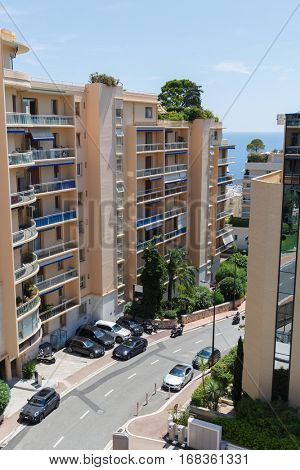 View of apartment building and street of one of densely populated districts of Monaco