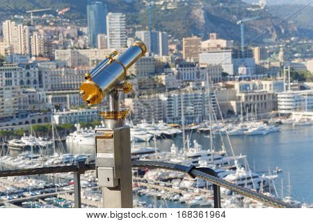 binoculars on observation deck of palace Grimaldi overlooking beach and bay of La Condamine