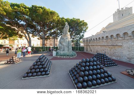 MONTE CARLO, MONACO - AUG 3, 2016: cannonballs and cannon near palace, which belongs to Prince of Monaco