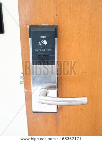 The door locked key card set up on old wood