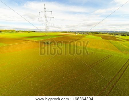 aerial view of fields and electrical tower